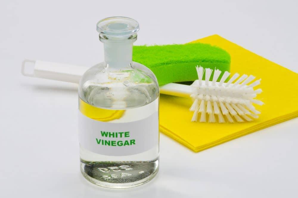 White vinegar in a glass bottle.