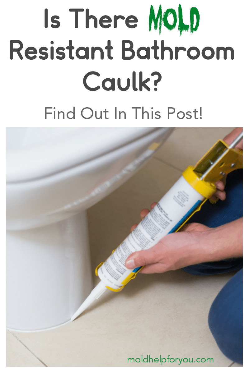 A handyman using mold resistant bathroom caulk around the toilet