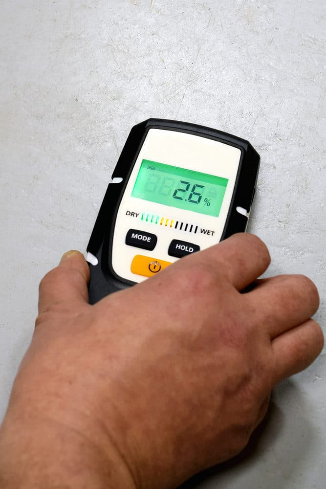 Search mode moisture meter on a wall. Also known as a pinless moisture meter.
