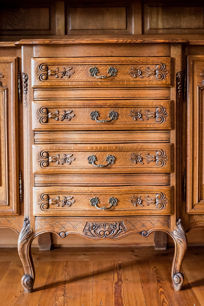 Antique wood carved chest of drawers after mold has been removed